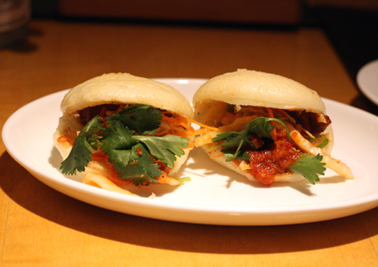 Housemade pork buns with fiery kimchee.