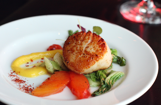 Day boat scallop with a smear of corn pudding and compressed nectarines.