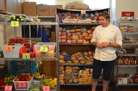 Chef Joey Elenterio of Chez TJ shops in the food pantry for ingredients for his dish. (Photo courtesy of West Valley Community Services)