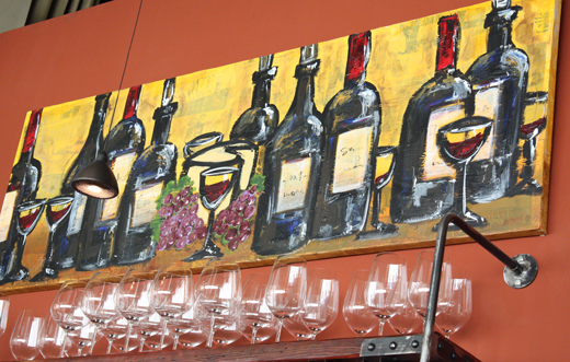 One of the colorful paintings and murals that adorn the dining room.