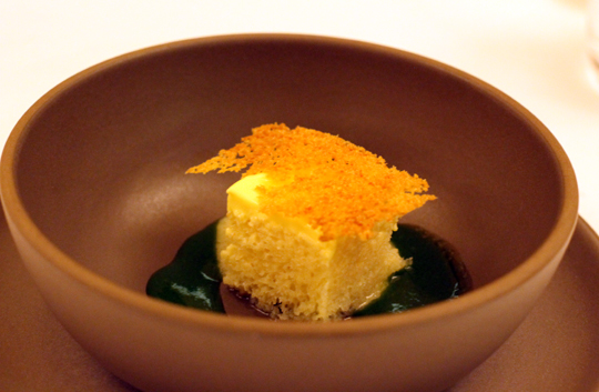 An airy cube of passion fruit baba with shiso syrup.
