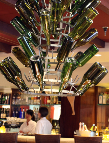 Wine bottle chandelier in the main dining room.