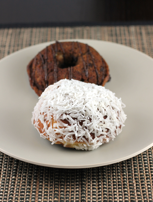 "Fonuts ""Hawaiian'' donut (front) and ""Banana Chocolate'' (back)."
