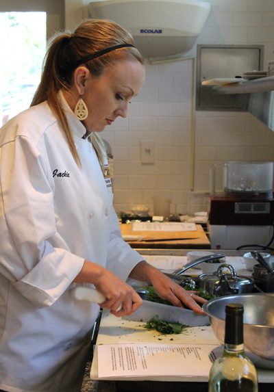 Jackie Dodd prepping herbs and vegetables for her chicken things with avocado lime quinoa salad.