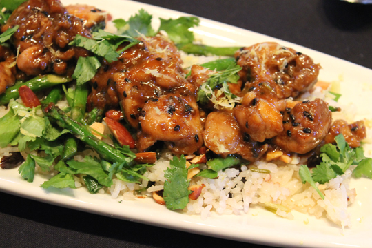 Lemon-Hoisin Glazed Chicken on Roasted Asparagus and Cherry Sesame Rice, as plated by finalist Merry Graham. Each dish was plated twice -- once by the contestant and once by CIA staff -- to show the possibilities.