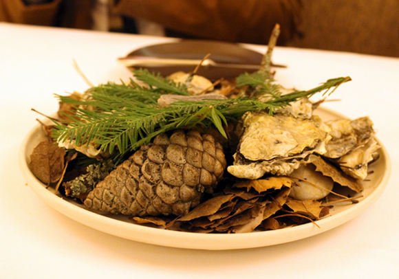 Oysters brought to the table on smoldering redwood branches at Coi in San Francisco, similar to the signature dish of scallops on smoky juniper branches at Faviken in Sweden.