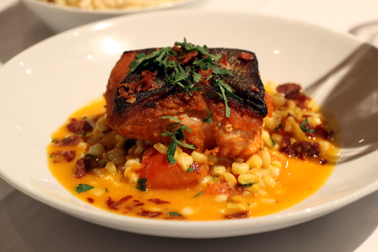 Perfect salmon with a stew of late-summer tomatoes in saffron.