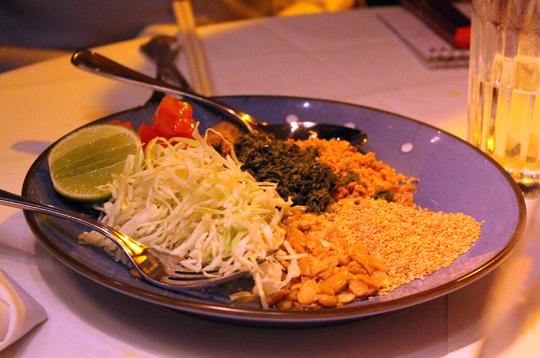 Tea leaf salad arrives as a digestive or palate cleanser.