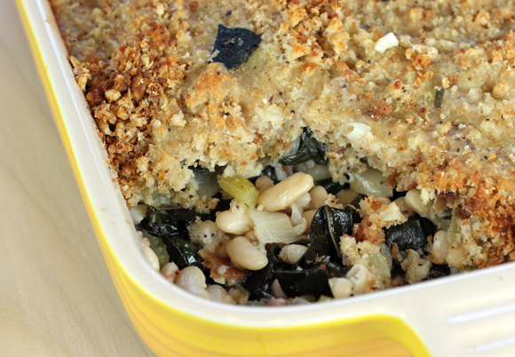 A cheesy crust of bread crumbs hides a filling of creamy white beans and kale.
