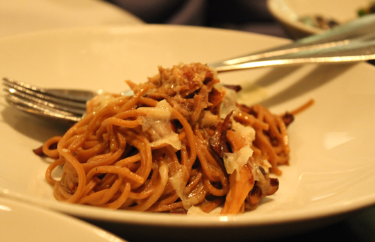 Long strands of pasta tossed with chunks of pork ragu.