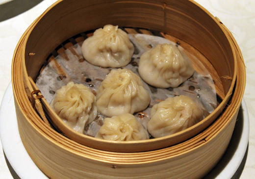 A half dozen soup dumplings, steamed to order.
