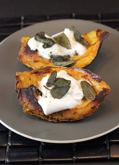 Roasted acorn squash wedges topped with rich, creamy burrata.