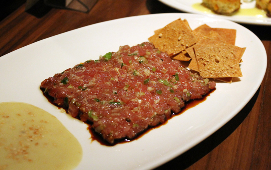 Finely chopped ahi tartare with a kiss of horseradish and soy sauce.