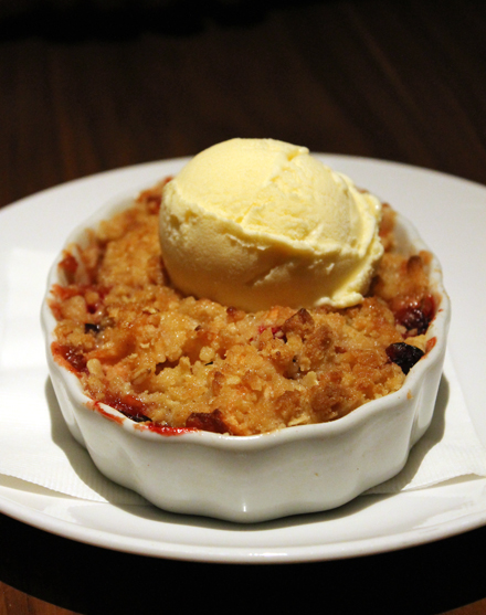 Apple and cranberry crisp with vanilla ice cream.