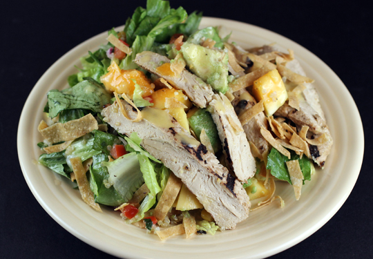 Baja Fiesta salad with grilled chickin' (wheat gluten), papaya and avocado.