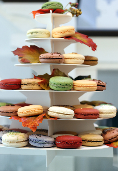 A macaron display on the counter.