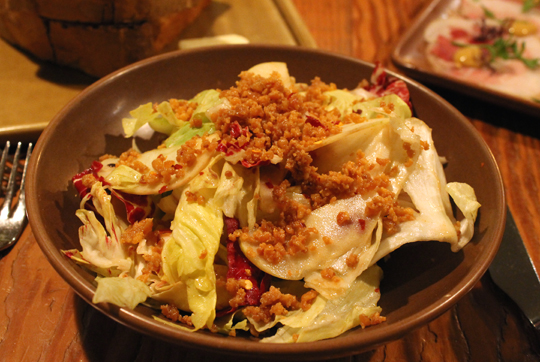 Crumbles of crunchy chicken skin top this chicory salad with apples.