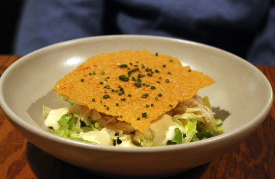 Crab salad with a giant house-made saltine cracker on top.