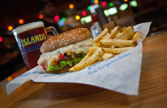 "The ""Nalu Nalu'' burger with roasted garlic aioli, provolone and mixed peppers. (Photo courtesy of Islands)"