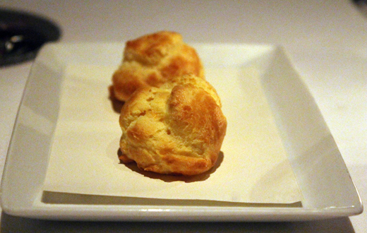 Warm gougeres welcome guests.