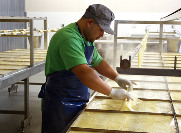 A worker making tofu skins at Hodo Soy Beanery. (Photo by Carolyn Jung)