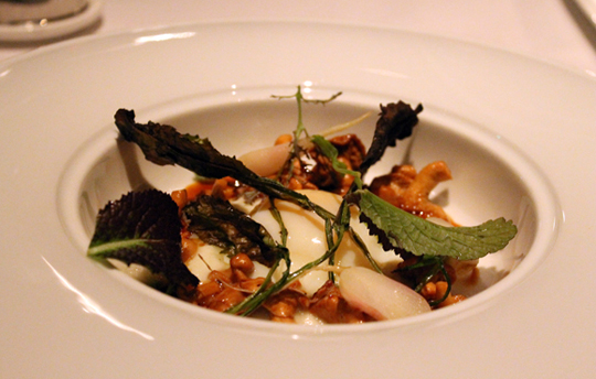 A farm egg tops an appetizer of mushrooms and Tokyo turnips.