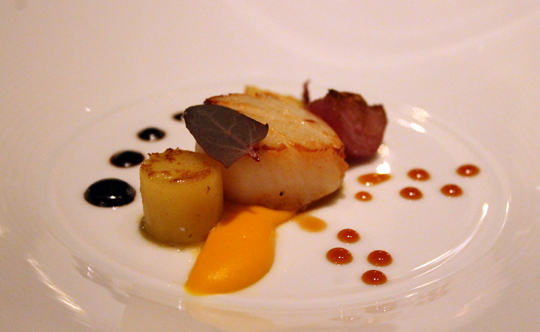 A plump seared scallop with sweet potato puree.