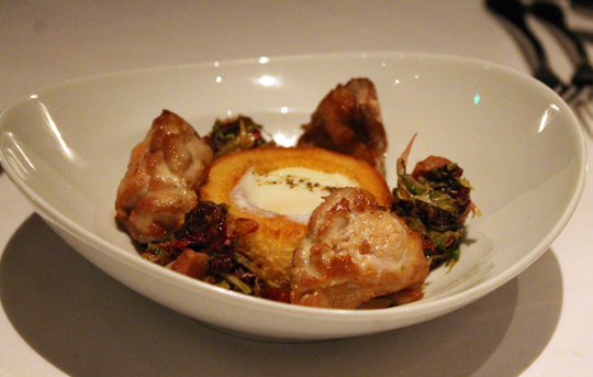 A runny farm egg also accompanies a dish of crisp sweetbreads.