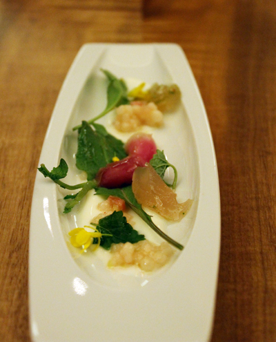 An amuse of radish and couscous.