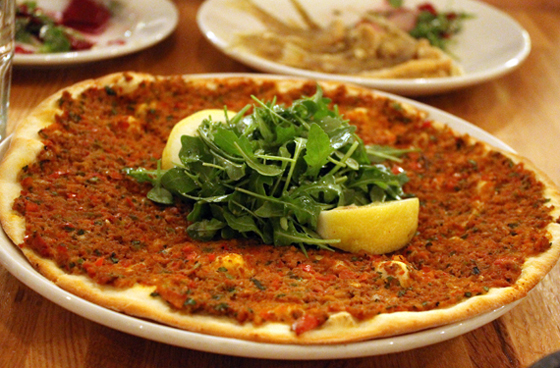 Flatbread smeared with a thick tomato-minced beef sauce at Troya.