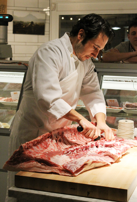 A butcher making porchetta at Belcampo Meat Co. in Larkspur.