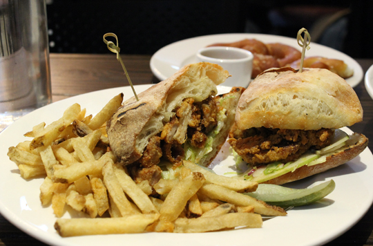 Fried chicken sandwich with fries.