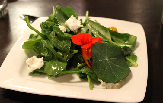 A spinach salad as part of a three-course dinner at Harvest restaurant.