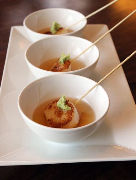 "Scallop ""shots'' with ginger-scallion pesto in dashi."