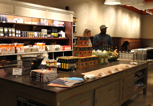The back part of the store features chocolate, condiments and other gourmet fare for sale.