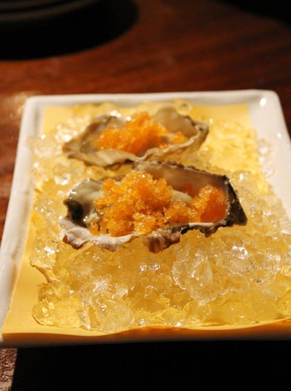 Oysters with icy sriracha granita.