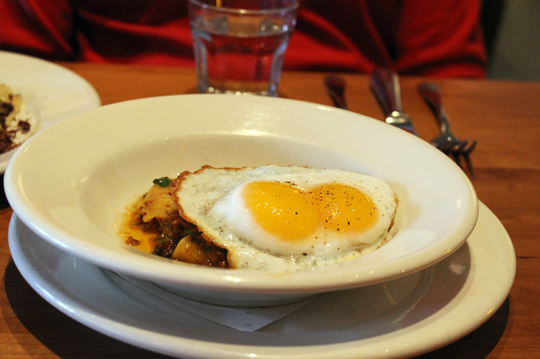 Hankerchief pasta with a fried duck egg with a double yolk.