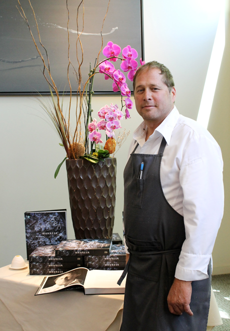 Chef-Owner David Kinch of Manresa stands in front of a display of his new cookbook, hot off the presses.
