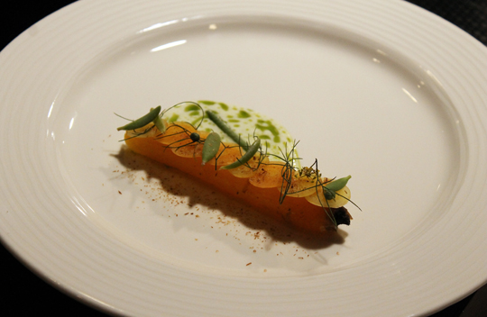 Such as in Brock's dish, where the water content of a carrot is lessened from being cooked in hot sand, thereby concentrating its flavor.