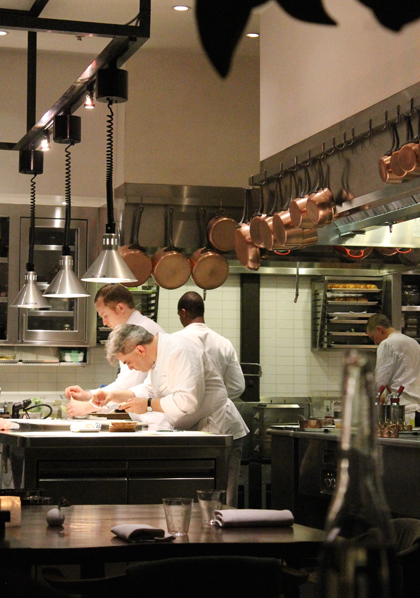 The two chefs assembling a dish.