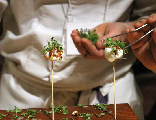 Andre Chiang of Restaurant Andre in Singapore adds the finishing touches to smoked potato and scallop fondue pops.