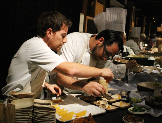 Chef Christopher Kostow of the Restaurant at Meadowood getting a helping hand.