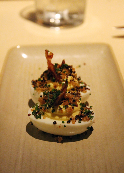 Deviled eggs with bacon and quinoa.
