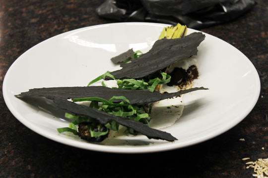 Frederiksen's charred winter leeks with malt powder and ash-like crackers.