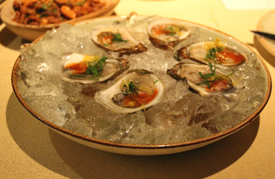 Oysters with house-made hot sauce.