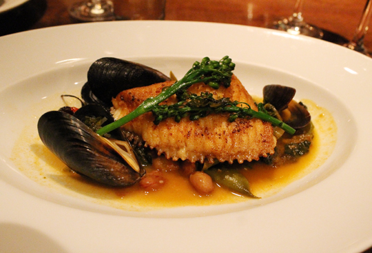Skate wing with mussels.