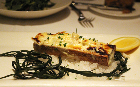 Bone marrow crowned with crab gratin.