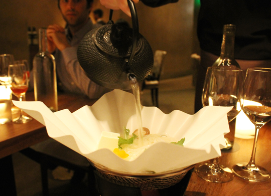 Hot broth poured tableside.