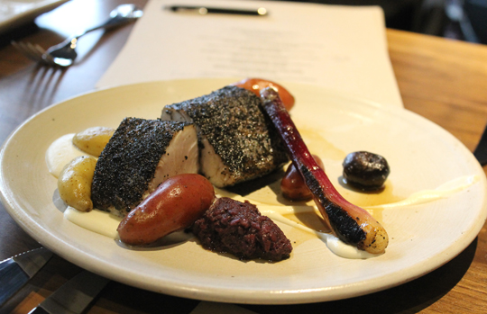 Kingfish with fingerlings and black trumpet mushrooms.