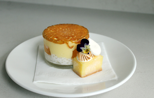 Lemon meringue brulee with its many hidden layers.